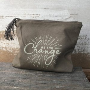 Pouch with be the change inscription