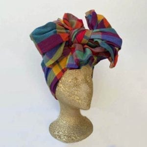 A madras headwrap on a manequin